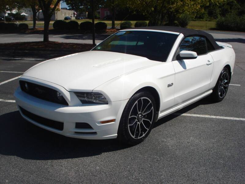 2013 Ford Mustang for sale at Uniworld Auto Sales LLC. in Greensboro NC