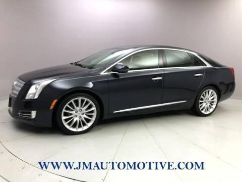2013 Cadillac XTS for sale at J & M Automotive in Naugatuck CT