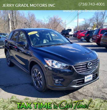2016 Mazda CX-5 for sale at JERRY GRADL MOTORS INC in North Tonawanda NY