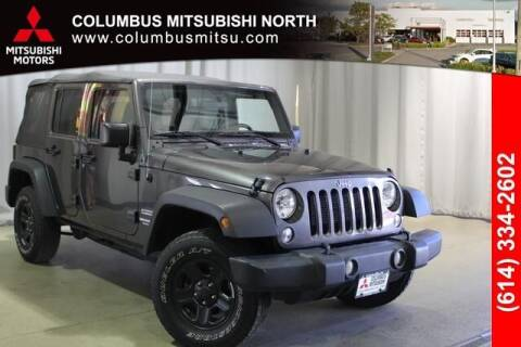 2017 Jeep Wrangler Unlimited for sale at Auto Center of Columbus - Columbus Mitsubishi North in Columbus OH