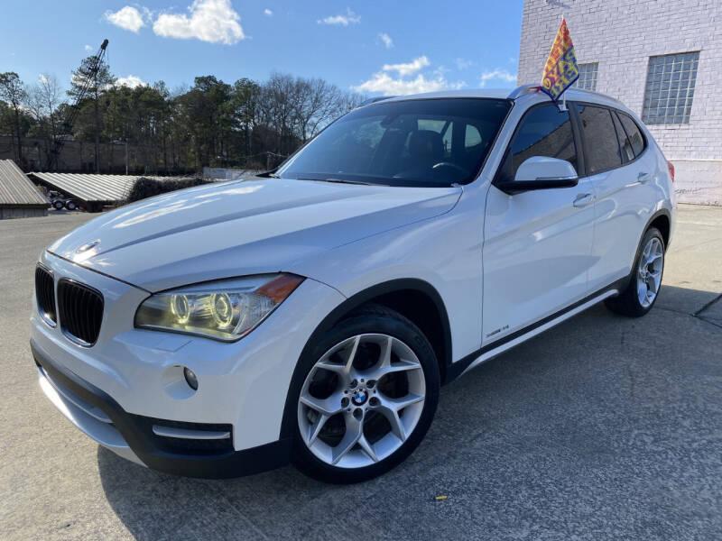 2014 BMW X1 for sale at JES Auto Sales LLC in Fairburn GA