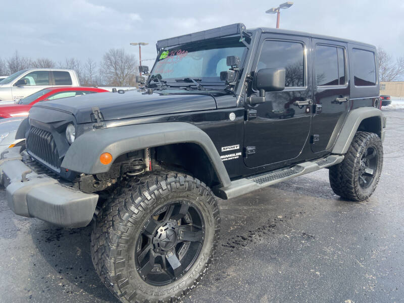 2013 Jeep Wrangler Unlimited for sale at EAGLE ONE AUTO SALES in Leesburg OH