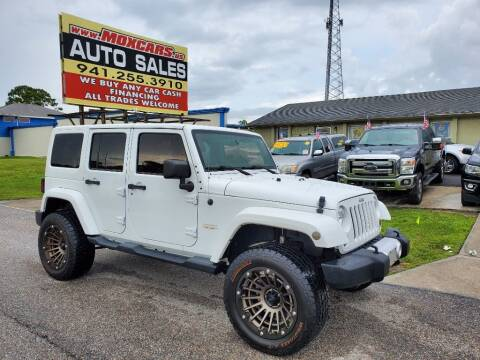 2014 Jeep Wrangler Unlimited for sale at Mox Motors in Port Charlotte FL