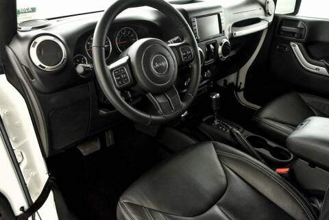 2016 Jeep Wrangler Unlimited for sale at CU Carfinders in Norcross GA