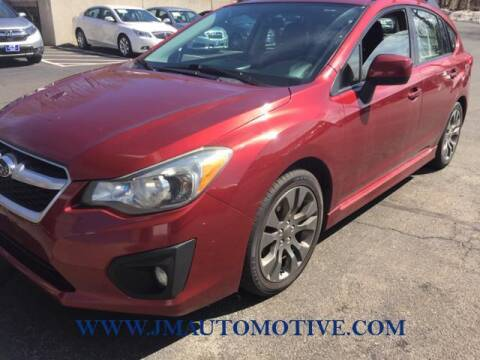 2012 Subaru Impreza for sale at J & M Automotive in Naugatuck CT