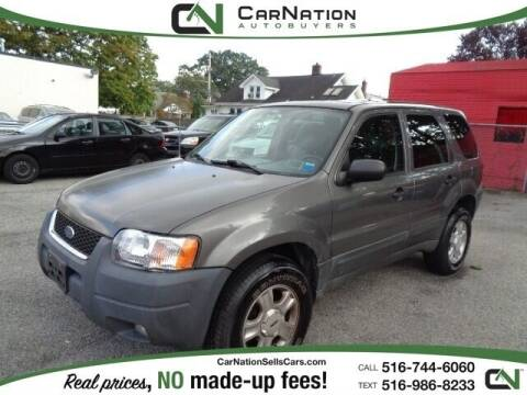 2003 Ford Escape for sale at CarNation AUTOBUYERS Inc. in Rockville Centre NY