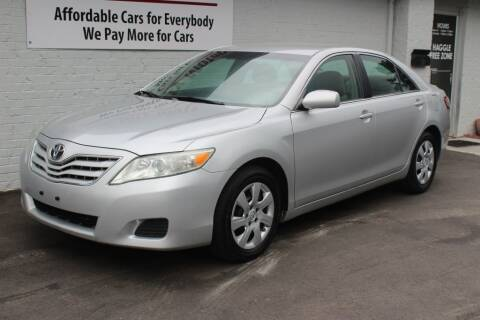 2011 Toyota Camry for sale at Oak City Motors in Garner NC