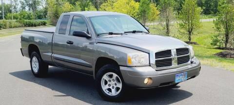 2007 Dodge Dakota for sale at BOOST MOTORS LLC in Sterling VA