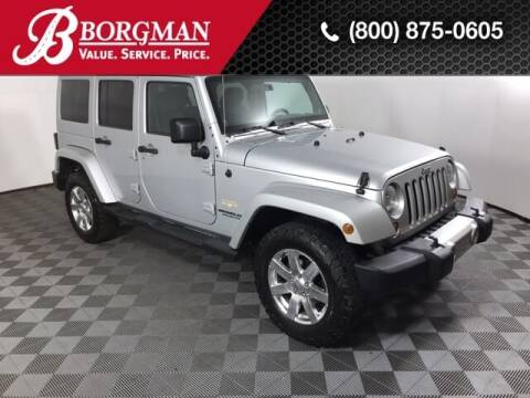 2012 Jeep Wrangler Unlimited for sale at BORGMAN OF HOLLAND LLC in Holland MI