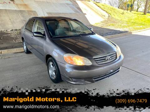 2003 Toyota Corolla for sale at Marigold Motors, LLC in Pekin IL