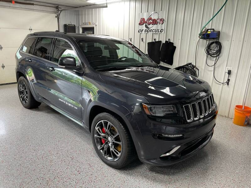 2014 Jeep Grand Cherokee for sale at D-Cars LLC in Zeeland MI