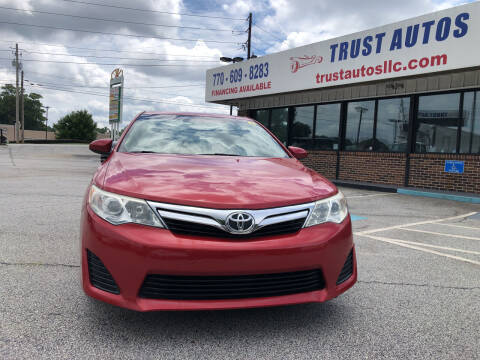 2012 Toyota Camry for sale at Trust Autos, LLC in Decatur GA