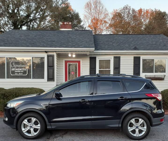 2014 Ford Escape for sale at SIGNATURES AUTOMOTIVE GROUP LLC in Spartanburg SC