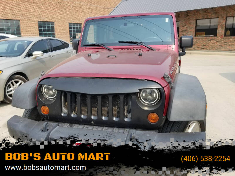 2011 Jeep Wrangler Unlimited for sale at BOB'S AUTO MART in Lewistown MT