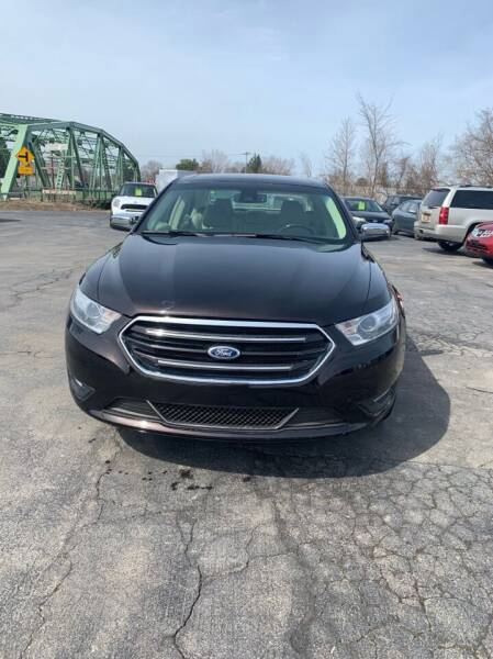 2014 Ford Taurus for sale at WXM Auto in Cortland NY