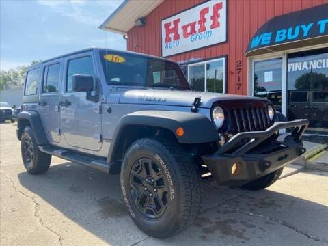 2016 Jeep Wrangler Unlimited for sale at HUFF AUTO GROUP in Jackson MI