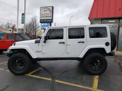 2013 Jeep Wrangler Unlimited for sale at Select Auto Group in Wyoming MI