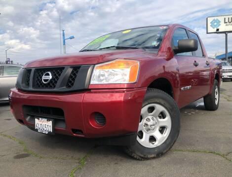 2014 Nissan Titan for sale at LUGO AUTO GROUP in Sacramento CA