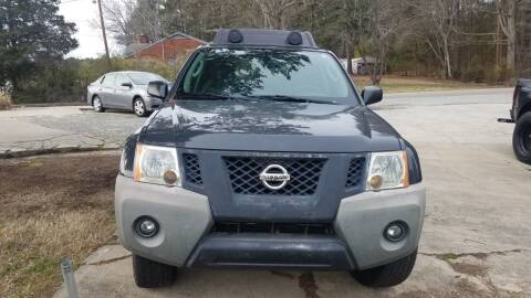 2011 Nissan Xterra for sale at Moore's Motors in Durham NC
