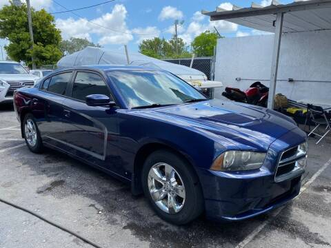 2014 Dodge Charger for sale at Maxicars Auto Sales in West Park FL