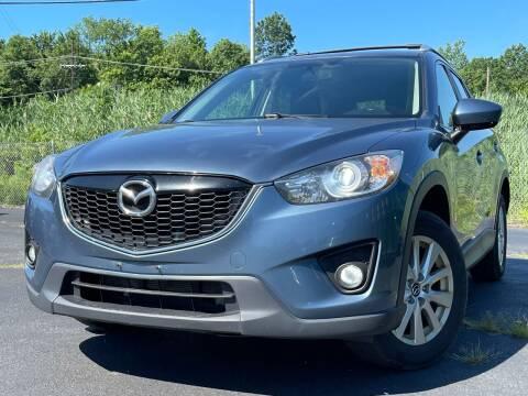 2014 Mazda CX-5 for sale at MAGIC AUTO SALES in Little Ferry NJ
