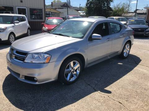 2013 Dodge Avenger for sale at ADKINS PRE OWNED CARS LLC in Kenova WV