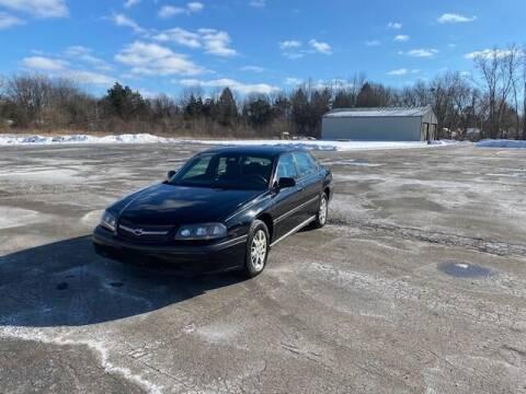 2004 Chevrolet Impala for sale at Caruzin Motors in Flint MI