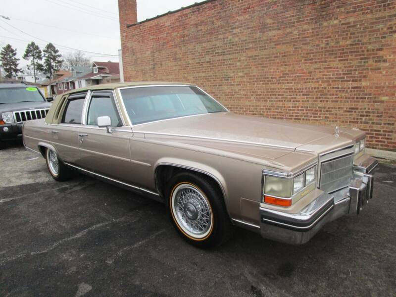 1985 Cadillac Fleetwood Brougham for sale at RON'S AUTO SALES INC - MAYWOOD in Maywood IL