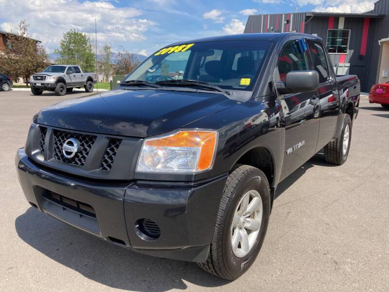2014 Nissan Titan for sale at Snyder Motors Inc in Bozeman MT