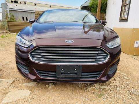 2013 Ford Fusion for sale at MAGNA CUM LAUDE AUTO COMPANY in Lubbock TX
