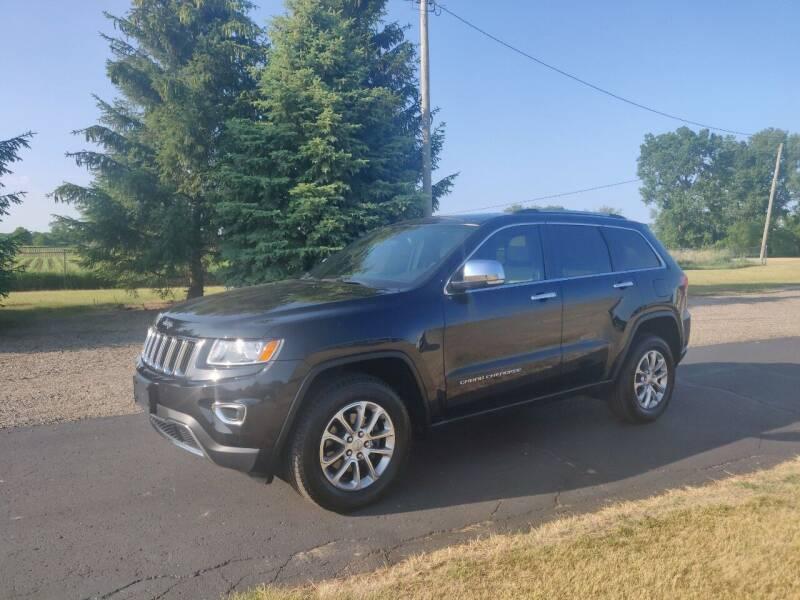 2014 Jeep Grand Cherokee for sale at Carmart Auto Sales Inc in Schoolcraft MI