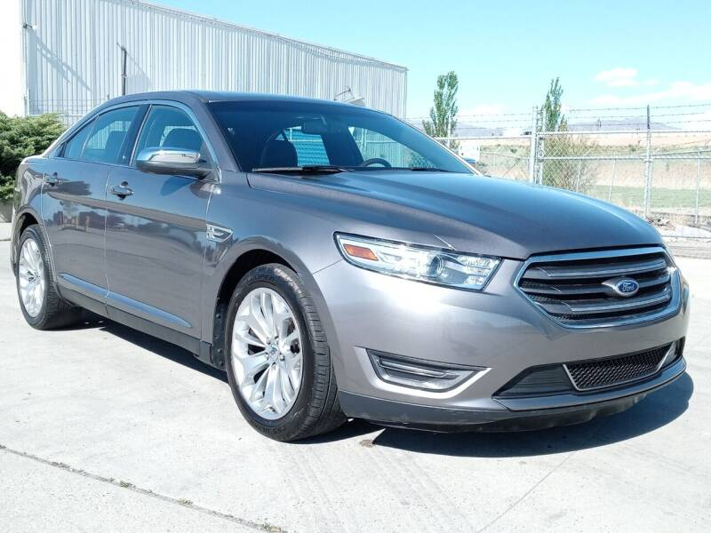 2013 Ford Taurus for sale at AUTOMOTIVE SOLUTIONS in Salt Lake City UT