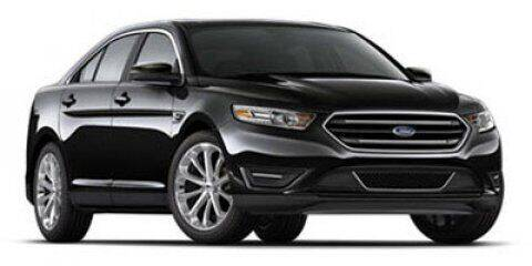 2012 Ford Taurus for sale at HILAND TOYOTA in Moline IL