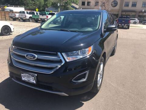 2017 Ford Edge for sale at BERKENKOTTER MOTORS in Brighton CO