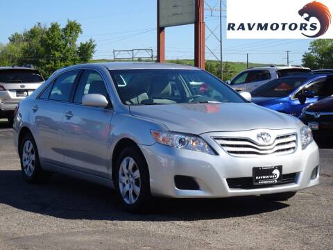 2011 Toyota Camry for sale at RAVMOTORS in Burnsville MN