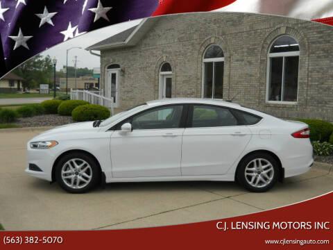 2014 Ford Fusion for sale at C.J. Lensing Motors Inc in Decorah IA