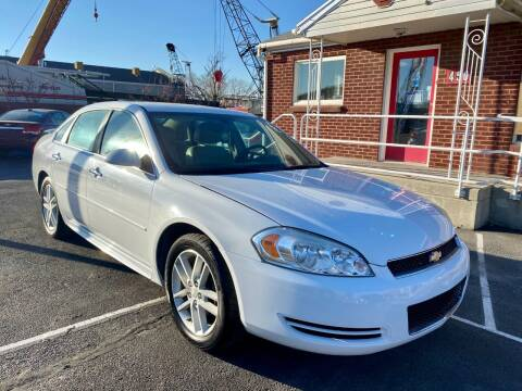 2013 Chevrolet Impala for sale at The Car-Mart in Murray UT
