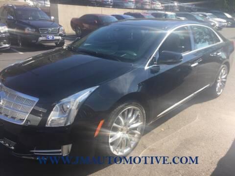 2013 Cadillac XTS for sale at J & M Automotive in Naugatuck CT