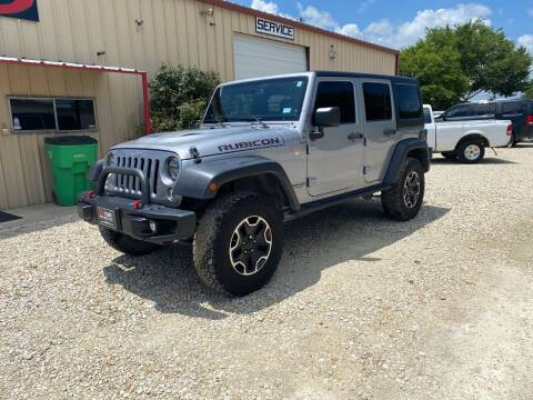 2014 Jeep Wrangler Unlimited for sale at Gtownautos.com in Gainesville TX