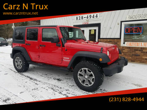 2010 Jeep Wrangler Unlimited for sale at Carz N Trux in Twin Lake MI