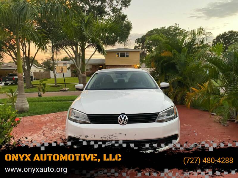 2011 Volkswagen Jetta for sale at ONYX AUTOMOTIVE, LLC in Largo FL