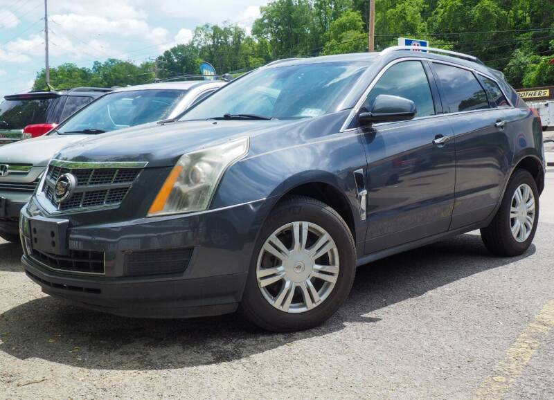2010 Cadillac SRX for sale at FAYAD AUTOMOTIVE GROUP in Pittsburgh PA