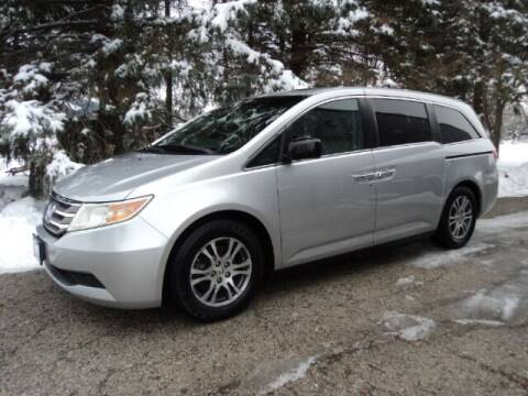 2012 Honda Odyssey for sale at HUSHER CAR CO in Caledonia WI