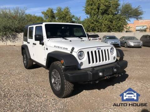 2017 Jeep Wrangler Unlimited for sale at Auto House Phoenix in Peoria AZ