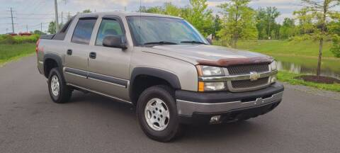 2003 Chevrolet Avalanche for sale at BOOST MOTORS LLC in Sterling VA