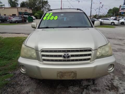 2002 Toyota Highlander for sale at SCOTT HARRISON MOTOR CO in Houston TX