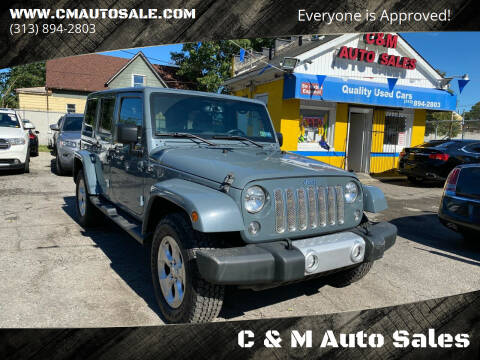 2015 Jeep Wrangler Unlimited for sale at C & M Auto Sales in Detroit MI