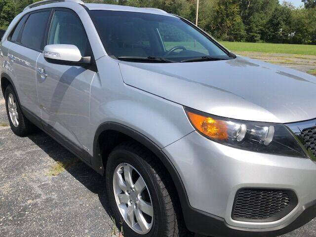 2011 Kia Sorento for sale at Global Autos in Kenly NC