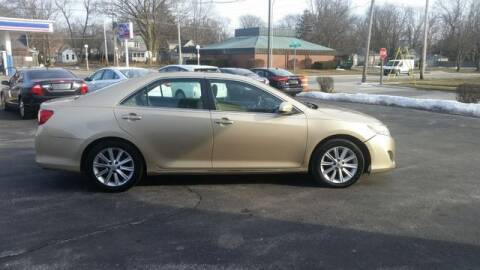 2012 Toyota Camry for sale at VINE STREET MOTOR CO in Urbana IL