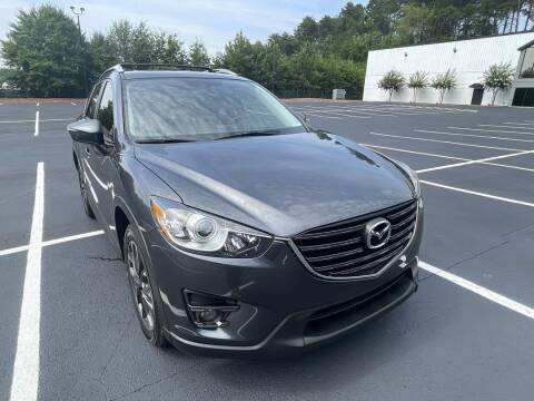 2016 Mazda CX-5 for sale at CU Carfinders in Norcross GA
